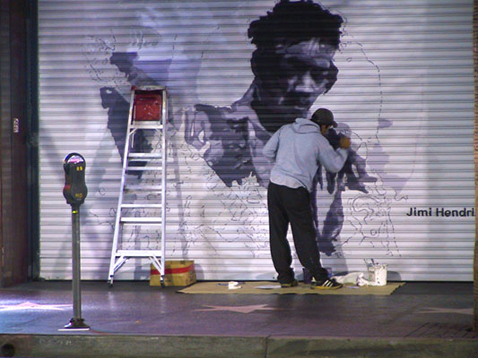 Artist painting the Jimmy Hendrix Door