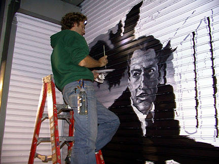 Artist painting the Vincent Price Door