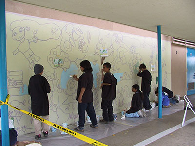 Students beginning work on the mural