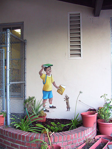 Boy with Kite Mural in School Courtyard